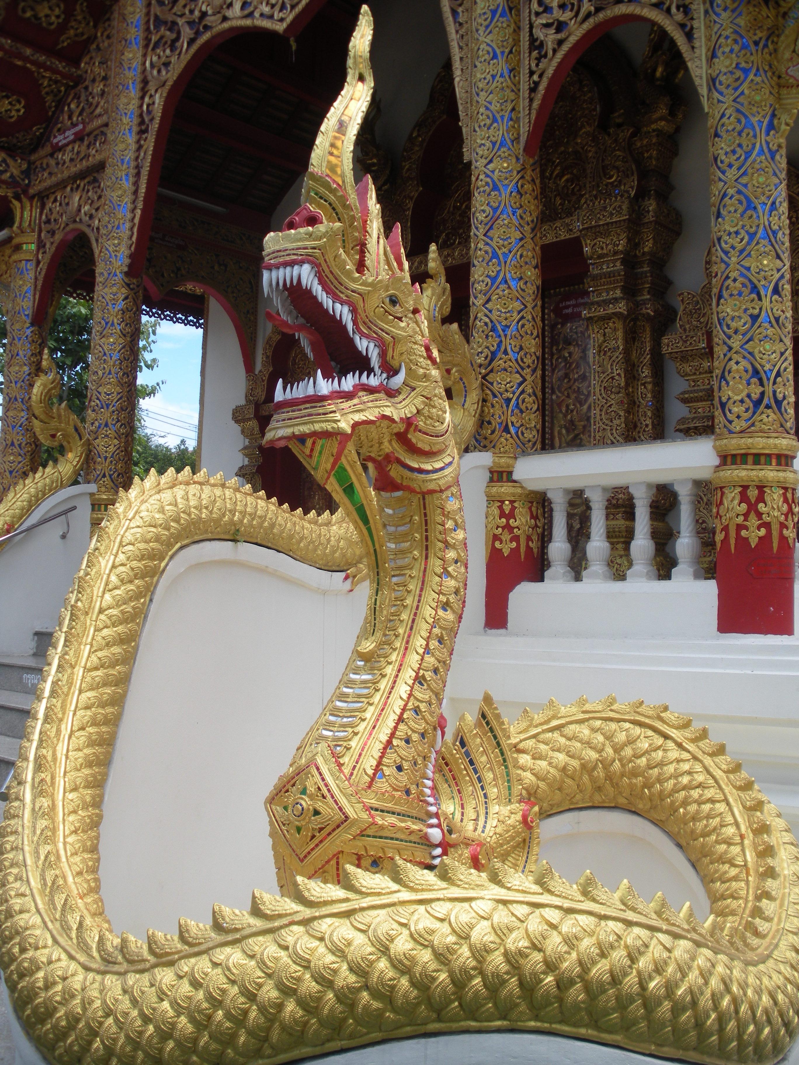 a golden naga, or serpent, guarding a temple