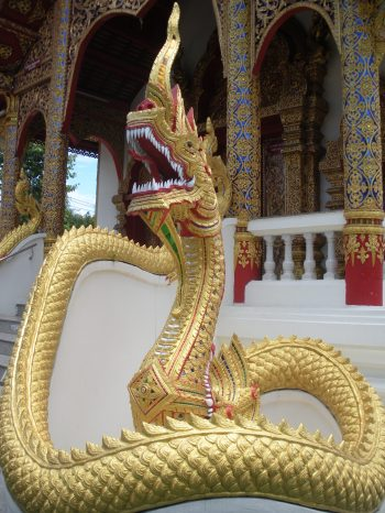 a golden naga, or serpent, guarding a temple