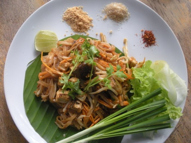a plate of delicious pad thai, so inexpensive and so good, from a great restaurant at the back of a magnificent temple!