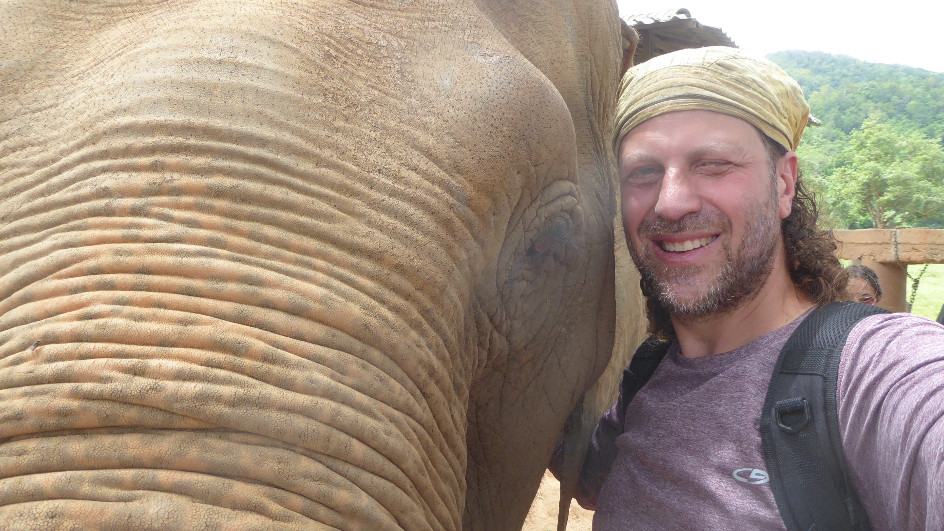 Dan Brook with an elephant at the amazing Elephant Nature Park sanctuary in Chiang Mai