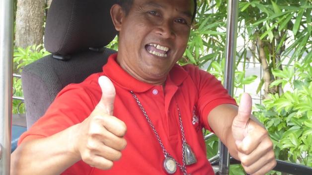 a happy tuk-tuk driver