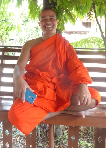 a happy monk named Phra Nanta at a temple in Chiang Mai