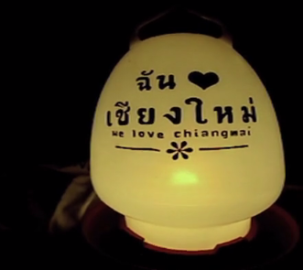 a yellow lantern that says: We Love Chiang Mai in English and Thai